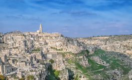 Panoramic view of typical stones (Sassi di Matera) and church near gravina of Matera UNESCO European Capital of Culture 2019 under Royalty Free Stock Photos