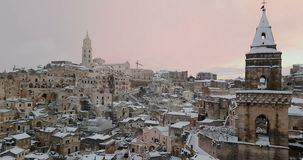 Panoramic view of typical stones Sassi di Matera and church of Matera 2019 with snow on the house, concept of travel and stock video footage