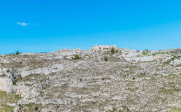 Panoramic view of typical stones Sassi di Matera near gravina of Matera UNESCO European Capital of Culture 2019 on blue sky Royalty Free Stock Image