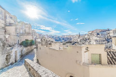Panoramic view of typical stones Sassi di Matera near gravina of Matera UNESCO European Capital of Culture 2019 on blue sky Stock Photos