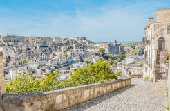 Panoramic view of typical stones Sassi di Matera near gravina of Matera UNESCO European Capital of Culture 2019 on blue sky Stock Photography
