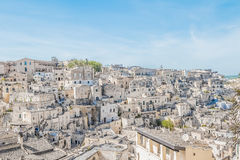 Panoramic view of typical stones Sassi di Matera near gravina of Matera UNESCO European Capital of Culture 2019 on blue sky Royalty Free Stock Photo