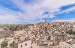 Panoramic view of typical stones (Sassi di Matera) and church of Matera under blue sky Royalty Free Stock Image