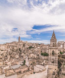 Panoramic view of typical stones (Sassi di Matera) and church of Matera under blue sky Stock Image