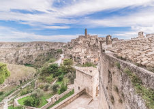 Panoramic view of typical stones (Sassi di Matera) and church of Matera under blue sky Stock Photo