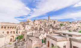 Panoramic view of typical stones (Sassi di Matera) and church of Matera under blue sky Royalty Free Stock Photography