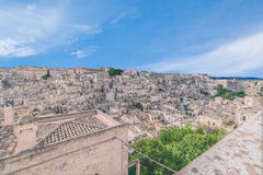 Panoramic view of typical stones (Sassi di Matera) and church of Matera under blue sky Stock Images