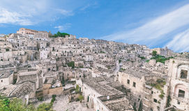 Panoramic view of typical stones (Sassi di Matera) and church of Matera under blue sky Royalty Free Stock Images