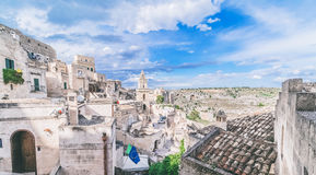 Panoramic view of typical stones (Sassi di Matera) and church of Matera under blue sky Royalty Free Stock Photo