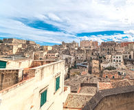 Panoramic view of typical stones (Sassi di Matera) of Matera under blue sky Stock Photography