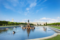 Neptune Fountain against Perterhof Grand Palace. Panoramic view of Upper gardens with Neptune Fountain and the Perterhof Grand Palace, St. Petersburg, Russia Royalty Free Stock Image