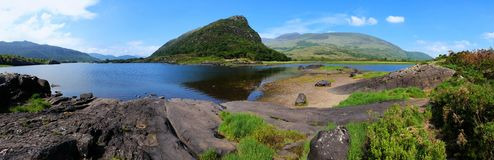 Panoramic view of lake and peaks in Killarney National Park, Ring of Kerry, Ireland. Panoramic view of Upper Lake and peaks in Killarney National Park, Ring of stock photography