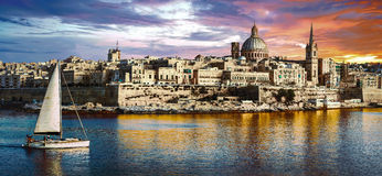 Panoramic view of Valetta over sunset and with a sail boat. Malt. Beautiful La Valletta over sunset,Malta island Stock Photos