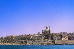 Panoramic view at Valletta city from Sliema bay, Malta. Panoramic view at Valletta city from Sliema bay. European island state of Malta royalty free stock photo