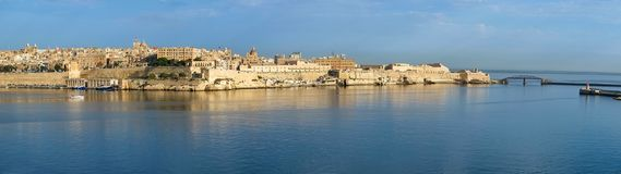 The panoramic view of Valletta and Grand harbor from the Kalkara. The panoramic view of Valletta capital city over the water of Grand harbor from the Kalkara Stock Photo
