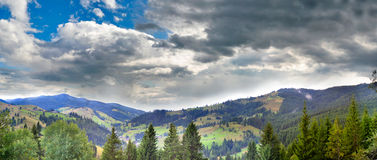 Panoramic view of a valley. Panoramic view over a valley in Carpathian Mountains, Moldavia counry. Just started to rain royalty free stock photos