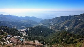 Panoramic view of the valley, Mussoorie. Panoramic view of the valley as seen from the mall road, Mussoorie. Uttarakhand, India. Towering Himalayan peaks are Royalty Free Stock Images
