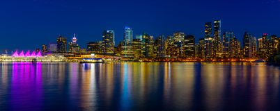 Panoramic view of Vancouver city by night royalty free stock image