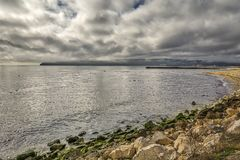 Panoramic view of the Varna bay , beach , rocks,birds, black sea and cloudy sky. Bulgaria stock image