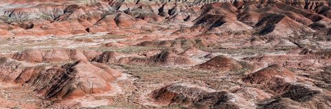 Panoramic view of a desert landscape of colorful peaks and hills royalty free stock photo