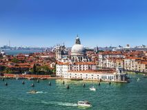 Panoramic view on Venice and the Basilica di Santa Maria della Salute from the bell tower of the Cathedral of San Giorgio Maggiore royalty free stock image