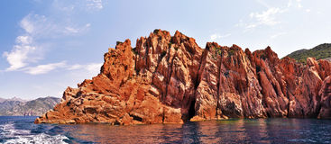 Panoramic view of vertical rocks of Calanques de Piana. Panoramic view of Magmatic vertical rocks of Calanques de Piana in Porto Bay of Corsica Island seen from royalty free stock photography