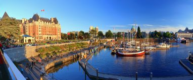 Empress Hotel and Parliament Building at Inner Harbour in Evening Light, Victoria, British Columbia. Panoramic view of Victoria`s Inner Harbour in evening light stock image