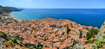Panoramic view of village Cefalu and ocean, Sicily Royalty Free Stock Image