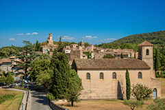 Panoramic view of the village of Lourmarin. Panoramic view of the village of Lourmarin, its main street and hills in the background. In the Vaucluse department Stock Photos