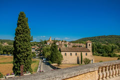 Panoramic view of the village of Lourmarin. Panoramic view of the village of Lourmarin, its main street and hills in the background. In the Vaucluse department Royalty Free Stock Images