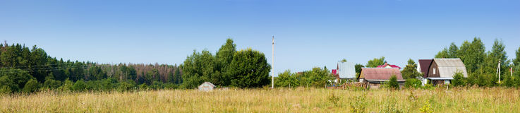 Panoramic view the village and meadow Royalty Free Stock Image