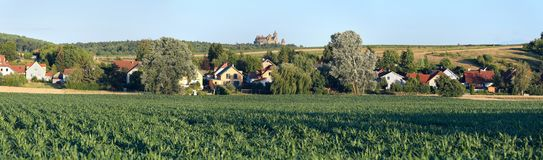 Panoramic view of the village Oberrohrbach with the Kreuzenstein Castle on a hill. Lower Austria, Europe. Panoramic view of the village Oberrohrbach. View of the stock images