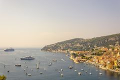 Panoramic view of Villefranche bay with boats and beaches. Cote d`Azur French Riviera is situated in the southern eastern part of the mediterranean coast of stock photo