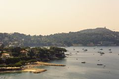 Panoramic view of Villefranche bay with boats and beaches. Cote d`Azur French Riviera is situated in the southern eastern part of the mediterranean coast of royalty free stock photo