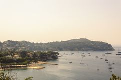 Panoramic view of Villefranche bay with boats and beaches. Cote d`Azur French Riviera is situated in the southern eastern part of the mediterranean coast of royalty free stock photography