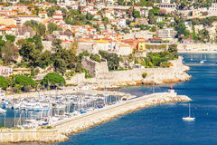 Panoramic view of Villefranche-sur-Mer, Nice, French Riviera. Panoramic view of coastline and beach with blue sky, luxury resort and bay with yachts, Nice port Royalty Free Stock Photos