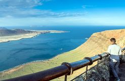 Panoramic view on the volcanic coastline and Isla Graciosa from Royalty Free Stock Photos