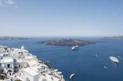 Panoramic view of volcano from caldera at Fira. Santorini island, Greece. Royalty Free Stock Photography