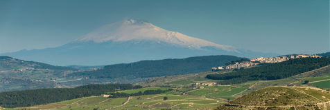 Panoramic view of Volcano Etna. A view of the Sicily`s south west countryside, and the country of Chiaramonte Gulfi on the right of the photo, dominated by Stock Photos