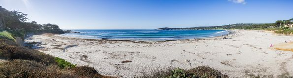 Panoramic view of Carmel State Beach, Carmel-by-the-sea, Monterey Peninsula, California. Panoramic view of the wahite sand Carmel State Beach on a sunny day royalty free stock photo