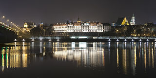 Panoramic view of Warsaw waterfront by night Royalty Free Stock Photo