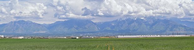 Panoramic view of Wasatch Front Rocky Mountains, Great Salt Lake Valley in early spring with melting snow and Cloudscape. Utah. America Royalty Free Stock Photography