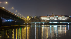 Panoramic view of a waterfront at night. Royalty Free Stock Image