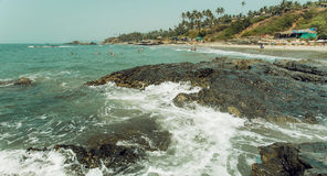 Panoramic view on wave of ocean waters and palm trees beach. Asian holiday landscape.  Stock Images
