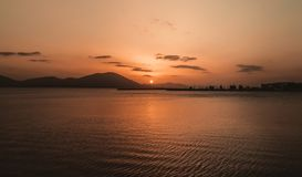 Panoramic view Waves and beautiful sunset on the Greek island in the Aegean Sea. Panoramic view Waves and sunset on the Greek island in the Aegean Sea stock image