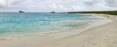 Panoramic view of white sand beach of Gardner bay Royalty Free Stock Photo