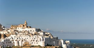 Panoramic view of the white village of Ostuni in Salento on the Adriatic sea. Salento is famous for its white villages and its seacoast with many wonderful stock images
