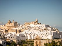 Panoramic view of the white village of Ostuni in Salento on the Adriatic sea. Salento is famous for its white villages and its seacoast with many wonderful stock image