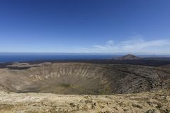 Panoramic view on the white volcanic crater `Caldera Blanca` in the Timanfaya National Park, Lanzarote, Canary Islands, Spain. Europe royalty free stock photography