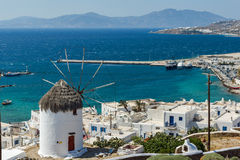 Panoramic view of white windmill and island of Mykonos, Greece Royalty Free Stock Images
